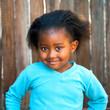 Cute african girl in blue top.