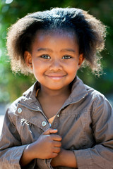Cute african girl in brown jacket.