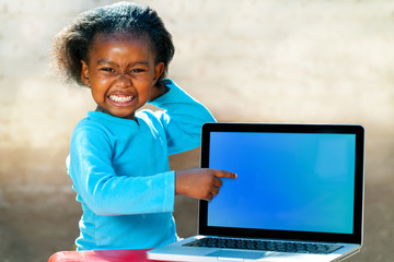Funny african girl pointing at blank screen.
