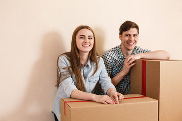 Smiling couple leaning on boxes