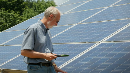 Expert Energy Engineer Counting Solar Power Panel