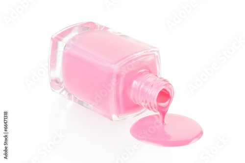 Poster Pink nail polish spilling isolated on white, clipping path