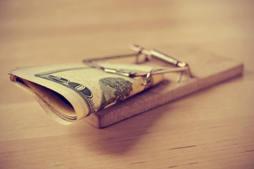 dollar bills in a mousetrap with a retro effect