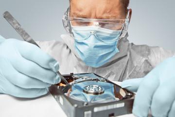 Man examines the hard disk