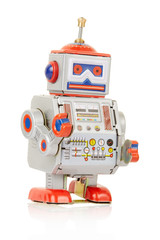 Robot vintage toy on white, clipping path