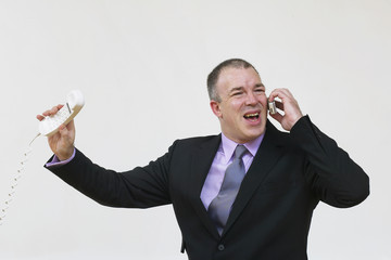 Businessman having animated conversation on telephone