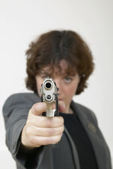 woman in suit with a gun