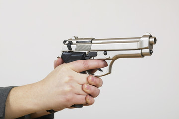 gun in a womans hands,Mid-adult woman