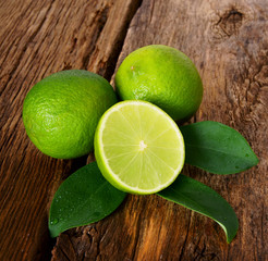 Limes. On wooden board.