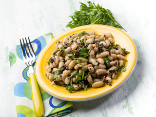 salad with  beans black olives and arugula