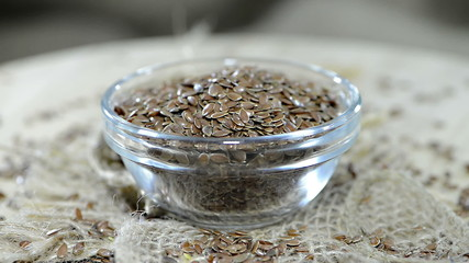 Flaxseeds in a bowl (not loopable)