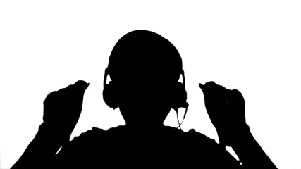 Close-up of girl listening to music in headphones and dancing.