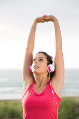 Woman on summer fitness workout stretching arms