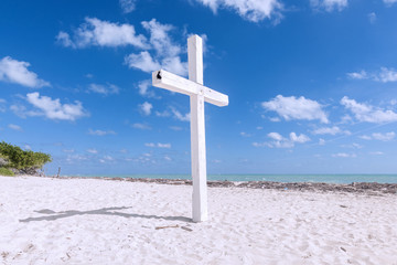 White cross on beach