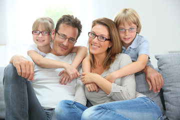 Portrait of happy family of four wearing eyeglasses