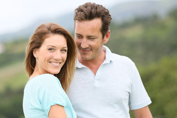 Portrait of loving couple in countryside