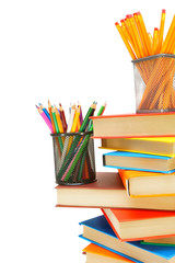 Pencils, baskets on the books