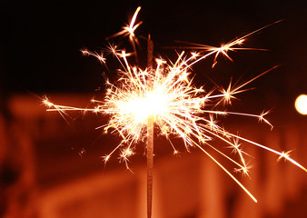 Bright Real Sparkler with A Construction in The Background