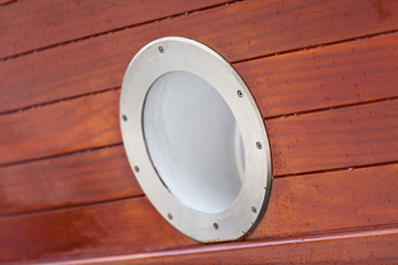 Wooden Ship porthole. View from outside