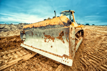 close-up of bulldozer blade, industrial machines working in sand