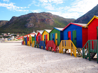 Row of wooden brightly colored huts