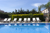 Summer outdoor swimming pool and sun loungers. poster