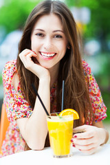 Woman drinking orange cocktail