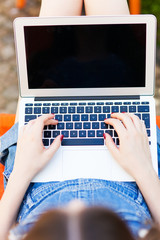 Girl using laptop, close-up