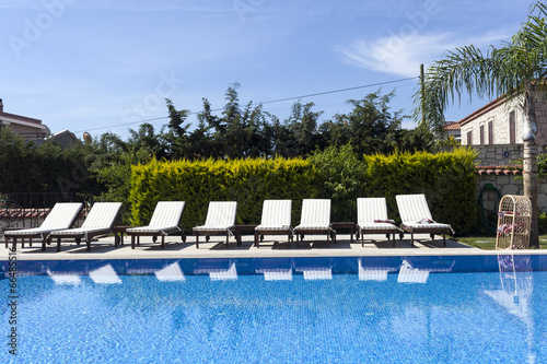 poster of Summer outdoor swimming pool and sun loungers.