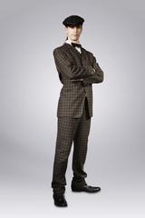 Man posing in retro style suit of twenties