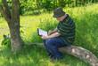 Mature painter doing sketch outdoor