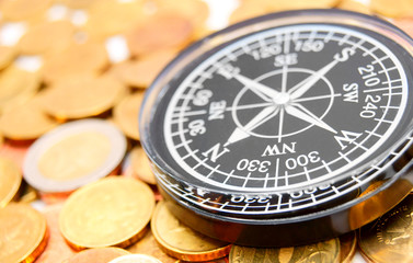 Compass on coins.