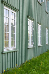 White wooden windows and green walls in Norway