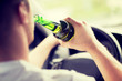 man drinking alcohol while driving the car - 66490398