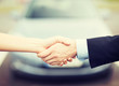 customer and salesman shaking hands