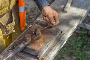 Worker bending spacers for the rebars in a concrete post