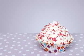 Cupcake on vintage retro background.