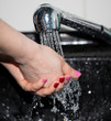 hand washing with tap water