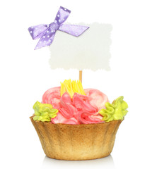 Cupcake with blank card on white background.