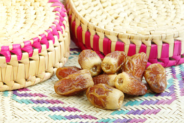 Delicious  dates kept on the mat of date palm leaves