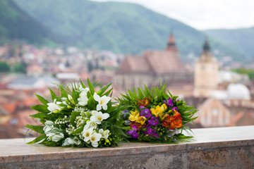 Wedding bouquet spring flowers with panoramic Brasov city view
