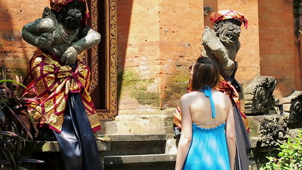 Woman looking at beautiful sculptures in temple, Ubud, Bali