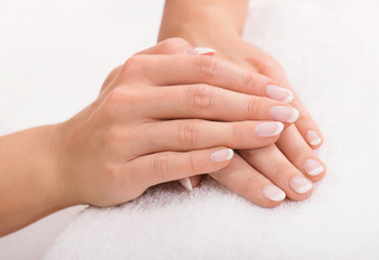 Hands on a towel with manicure