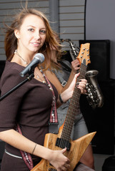 Pretty women with musical instruments