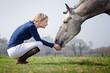 Leinwanddruck Bild - Reiterin mit Pferd