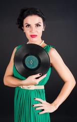 Pretty girl holding vinyl disc