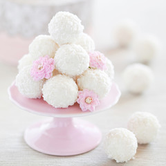 Coconut white chocolate truffles, selective focus