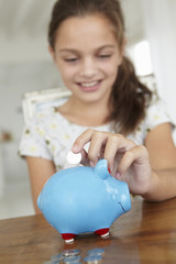 Young girl with piggy bank