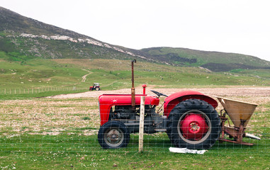 Vintage red tractor in a field in UK