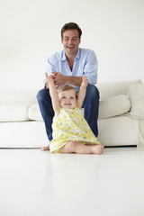 Father with baby daughter at home
